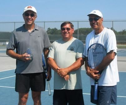 Three men, two holding tennis raquets